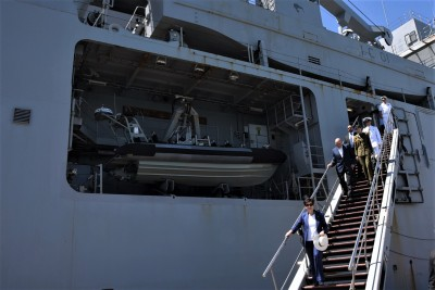 an image of Dame Patsy and Sir David descending the gangway from HMNZS Canterbury