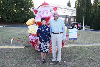 Image of Dame Patsy and Sir David with a pig shaped lantern