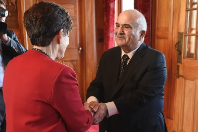 Image of Dame Patsy welcoming Prince Hassan