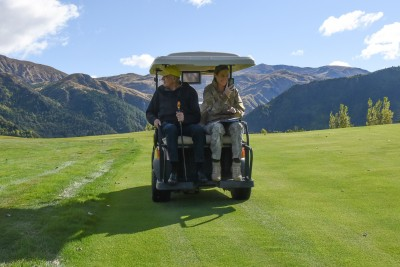 Image of Sir David Sir David and ADC Capt Grace Blanks cruising on the back of the golf cart