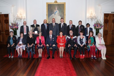 Image of Dame Patsy and Sir David with investiture recipients
