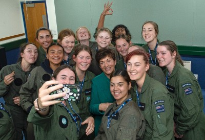 Image of Dame Patsy having a photo taken with School to Skies participants