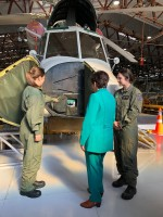 Image of Dame Patsy looking at a plane