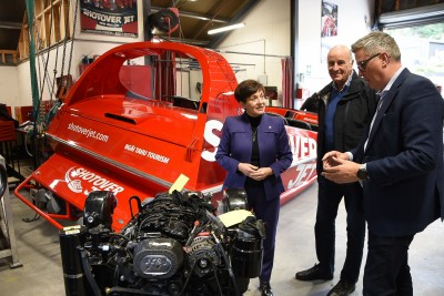 Image of DamePatsy and Sir David talking engines with Quinton Hall, CE of Ngai Tahu Tourism