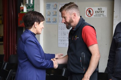 Image of Dame Patsy with a Shotover Jet staff member