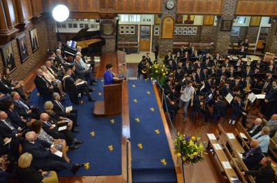 Dame Patsy addressing the commemorative Assembly at Auckland Grammar