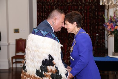 Dame Patsy greeting Mr Walter Walsh, of Gisborne, QSM for services to the community and broadcasting
