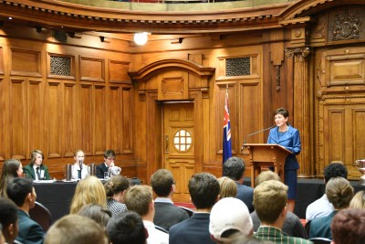 Image of Dame Patsy as Patron of the New Zealand School's Debating Council, addressing the audience