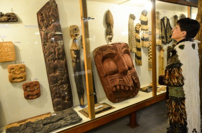 Carvings and clothing, including an early 20th century woven waistcoat