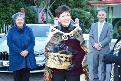 Dame Patsy with a kete woven by the custodian, Sharon Henderson