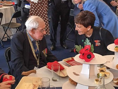 Image of Dame Patsy with a veteran at the veteran's lunch