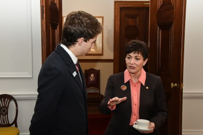 Image of Dame Patsy speaking with Samuel Morgan