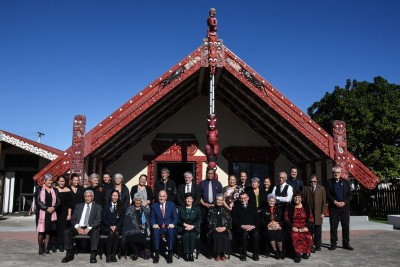 Image of Dame Patsy and Sir David with the people of Huria Marae