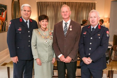 Image of Dame Patsy with recipient Garth Cowley and Kerry Gregory and Ron Devlin from Fire and Emergency NZ