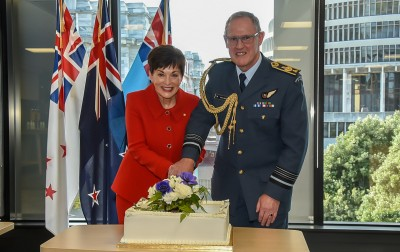 Dame Patsy cuts the cake with Chief of Defence, Air Marshall Kevin Short