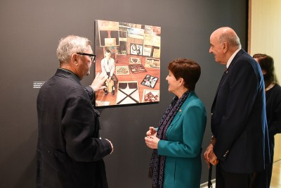 Image of Checking out an earlier photo of McCahon with Ron Brownson, Senior Curator, New Zealand and Pacific Art