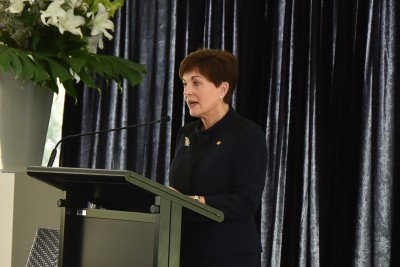 Image of Dame Patsy speaking before announcing the minute's silence