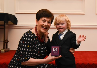 Dame Patsy received a candle from Eli Morton