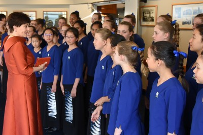 Image of Dame Patsy talking with members of the Auckland Girls' Choir