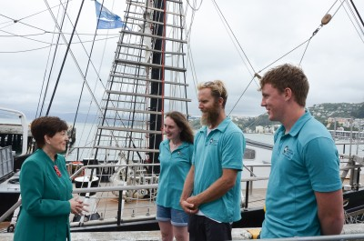 mage of On board the 'Spirit of New Zealand' with Ship's Master Nic Charrington and crew Hannah and Callum