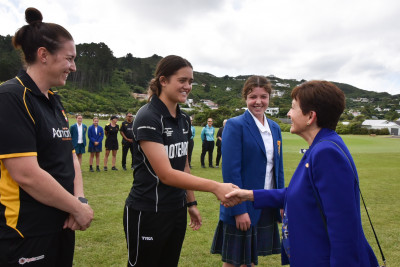 Three cricket captains line up and shake the Govenor-General's hand