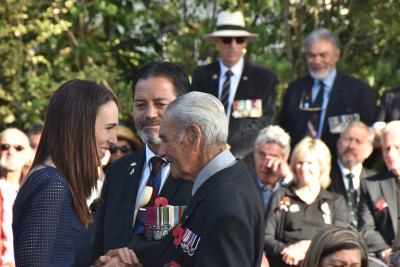 The Prime Minister greeting Bob Gillies, one of the two remaining 28 Maori Battalion veterans