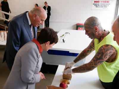 Image of Dame Patsy and Sir David Checking out the takeaway meals for ACM clients