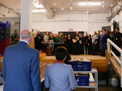 Image of Dame Patsy and Sir David listening to a waiata from the ACM team