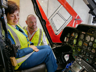 Dame Patsy Reddy in a helicopter at Life Flight