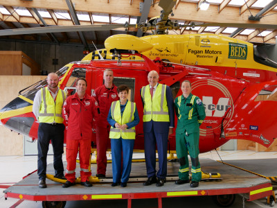 Dame Patsy Reddy and Sir David Gascoigne with the Life Flight Helicopter crew