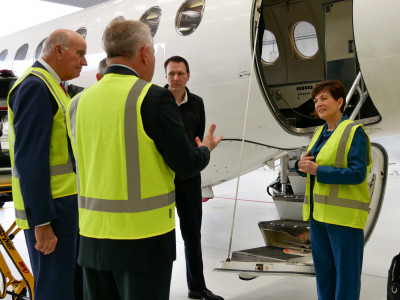 Dame Patsy Reddy and Sir David Gascoigne with the air ambulance