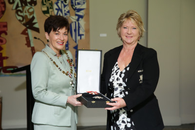 Karen Corlett receiving the insignia for Dame Yvette Corlett, DNZM for services to athletics