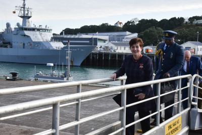 Image of Dame Patsy arriving aboard the HMNZS Aotearoa