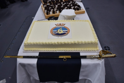 Image of a cake decorated with HMNZS Aotearoa's badge