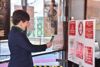 Image of Dame Patsy checking in with the Covid-19 app