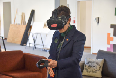 Image of Dame Patsy trying out a VR game