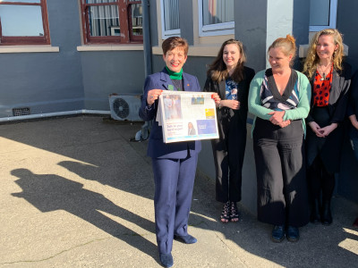 Image of Dame Patsy holding the Westport News