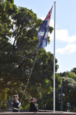 Naval officer and the New Zealand Flag