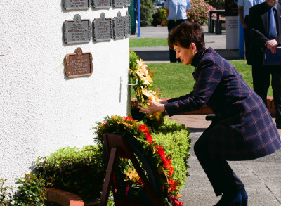 Dame Patsy laying a wreath on the Memorial Wall