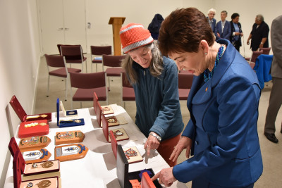 Image of Dame Patsy looking at the various insignia and pieces of Governor-General memorabilia