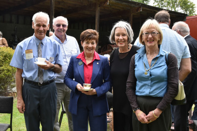 Dame Patsy Reddy with volunteers at Cobblestones Museum