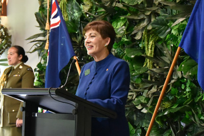 Dame Patsy Reddy speaking at a lectern