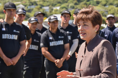 Dame Patsy speaks to the cricketers