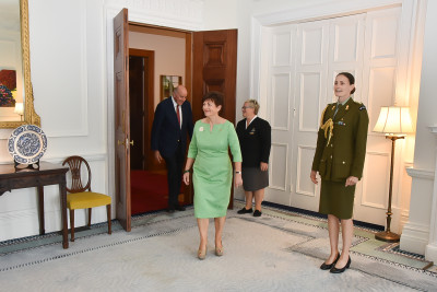 Image of patsy entering the drawing room