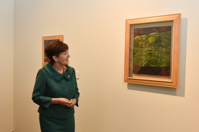 Dame Patsy with a Rita Angus painting from the John Money Collection