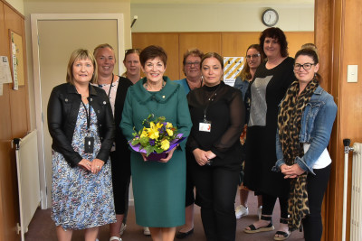 Dame Patsy with personnel from various agencies working under the umbrella of the Community Networking Trust