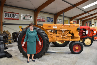 Dame Patsy and a tractor at Transport World