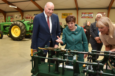 Jocelyn O'Donnell demonstrating a lolly wrapping machine to Their Excellencies