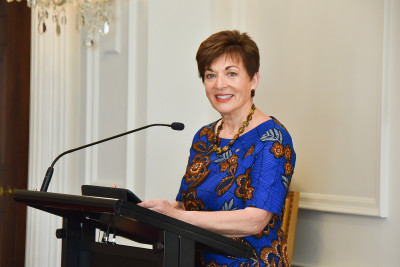 Image of Dame Patsy, about to speak
