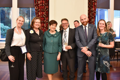 Image of Dame Patsy with guests at the reception